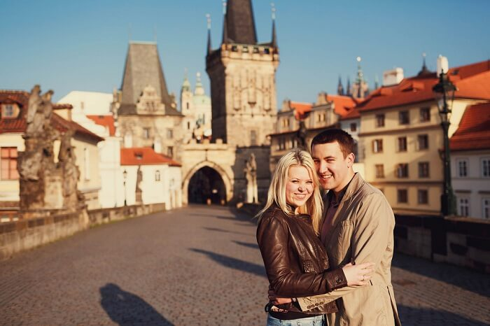 A couple on their honeymoon in Prague