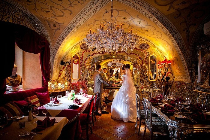 A couple ready to revive the marriage vows at the dining facility at Alchymist Nosticova Palace on their Prague honeymoon