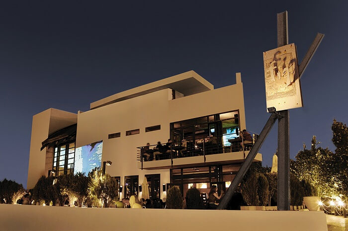 Guests dining at the Blue Fig cafe and pub in Amman