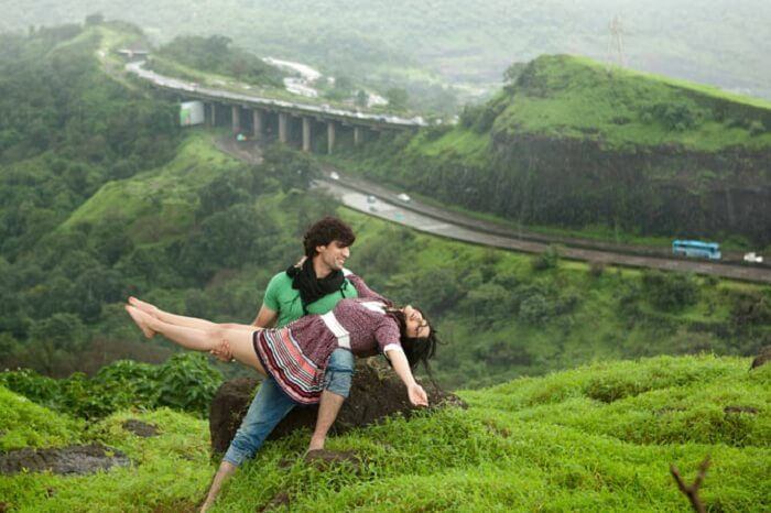 A couple poses for a romantic photo in Khandala