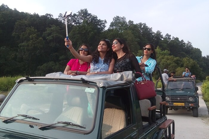 Girls taking selfie during a jeep safari in Jim Corbett