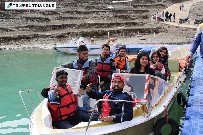 A group of travelers on a speedboat in Tehri dam on a weekend trip from Delhi to Kanatal