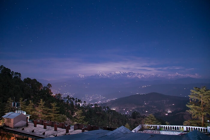 A night shot of the valley and hills as seen from a resort in Kausani