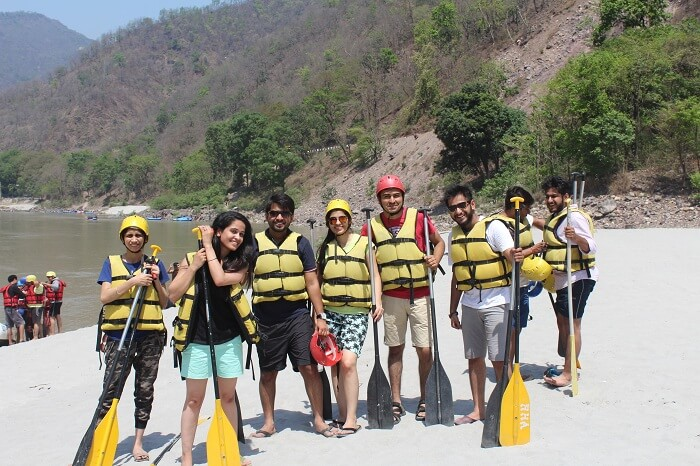 A group of travelers ready for river rafting on their weekend trip from Delhi to Rishikesh
