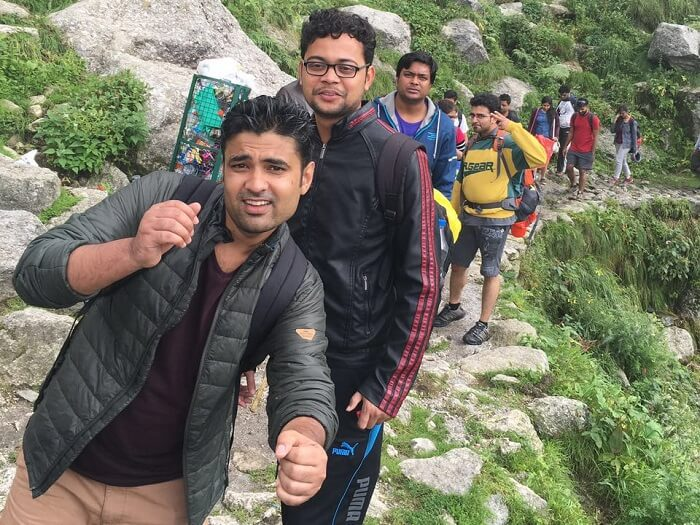 A group of travelers on one of the weekend trips from Delhi to Mcleodganj taking a trek to Triund