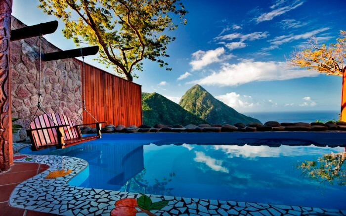 outdoor pool of a resort overlooking conical mountains