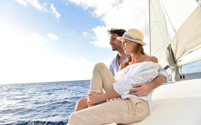 A couple onboard catamaran