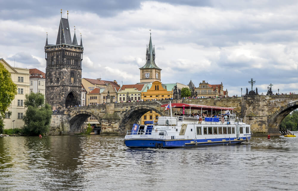 A view of a cruise on the river Vltava with the Charles Bridge in the background