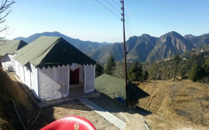 A Swiss tent of Wildex Camp in Kanatal with gorgeous mountain views around
