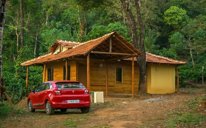 A car parked outside 27trees Homestay in Coorg