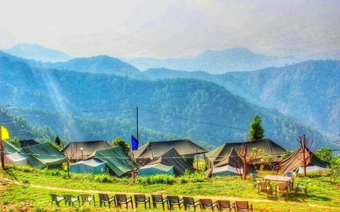 A glorious view of Kanatal Orchid Camps overlooking the vast mountains in Kanatal