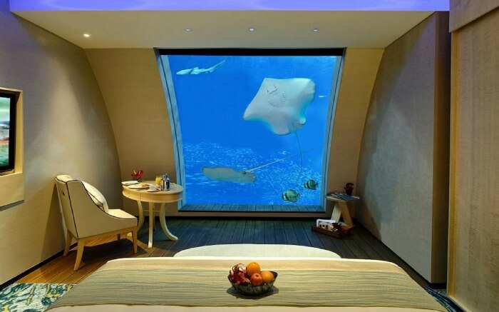 A resort room with an aquarium in it