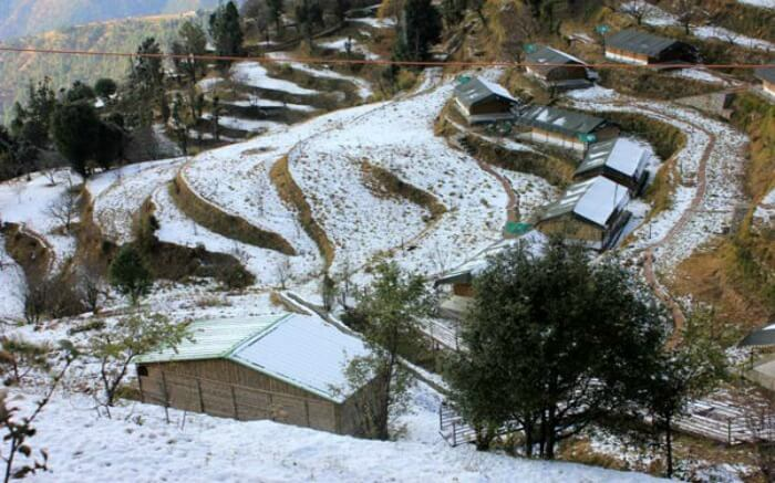 Camps of Little Jaguar on the contours of hill covered in snow