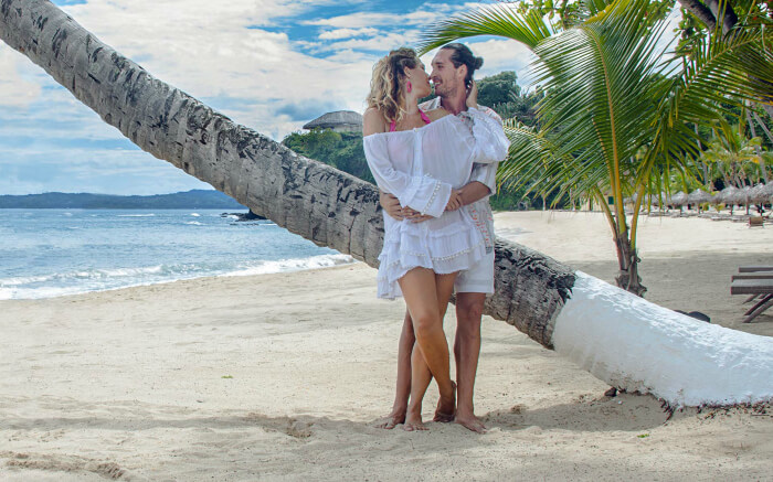 Couple romancing by a sea beach in Madagascar