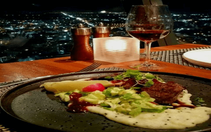 Dinner laid out on the dining table at 360-degree dining in Skytower