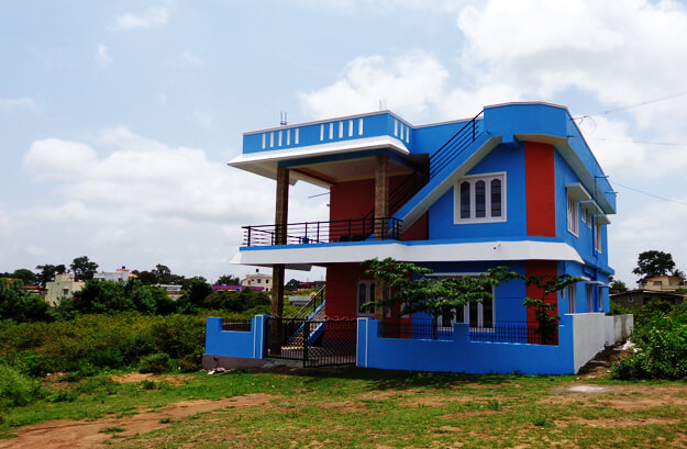 Dreamland Homestay building painted blue