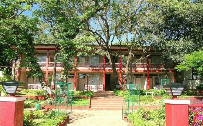 Front view of Regal Hotel in Matheran on a sunny day