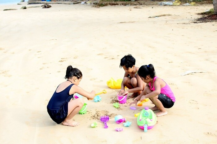 Kids making sandcastles on the beach