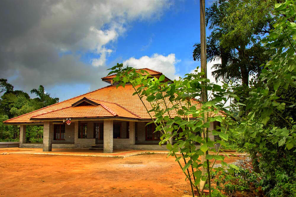 a traditional style Karnataka home with a huge verandah