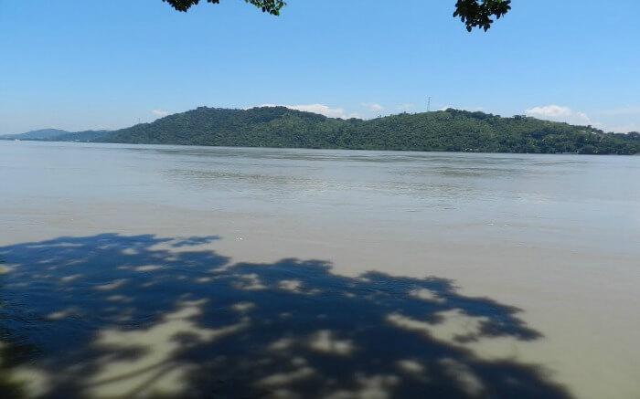 Kamakhya Hills from a beach s