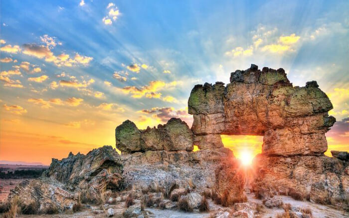 Morning sun peeking through the massive rock structure in Madagascar