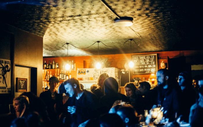 People celebrating and drinking at Darkroom in Christchurch in New Zealand