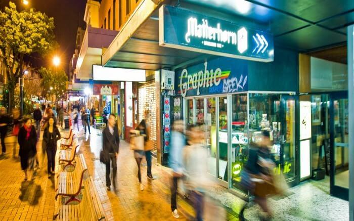 People walking past the shops in Cuba Street in Wellington