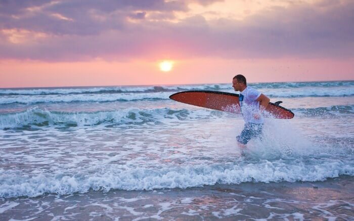 Surfer in a beach in Bali