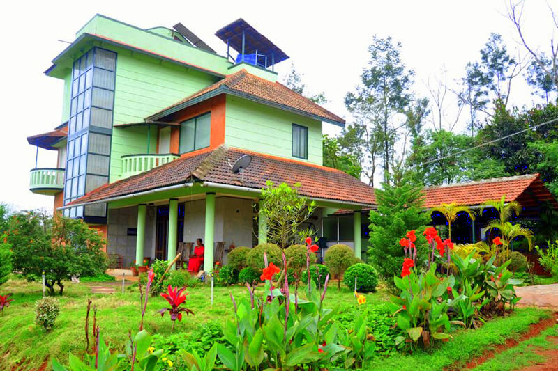 a Karnataka style home painted green