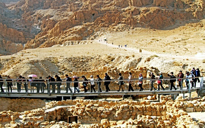Tourists crossing a bridge in Qumran in Israel