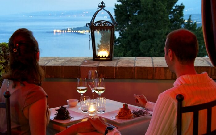 Couple dining at Sinclairs Bayview in Port Blair with the magnificent seaview in sight