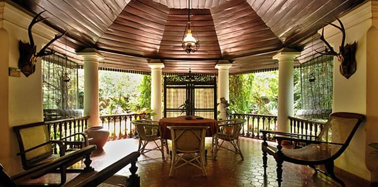 a traditional porch area on a hotel