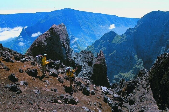 A couple trekking in Mafate on a honeymoon in Reunion Island