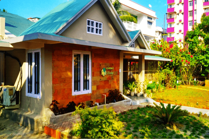 a colorful homestay with a garden