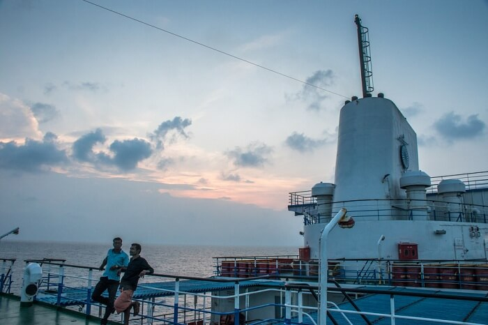 Passengers on deck of MV Kavaratti at sunset