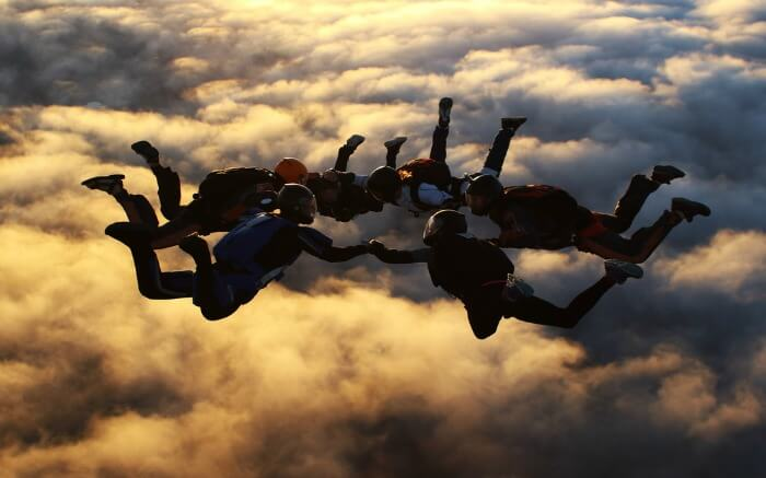 A group skydiving