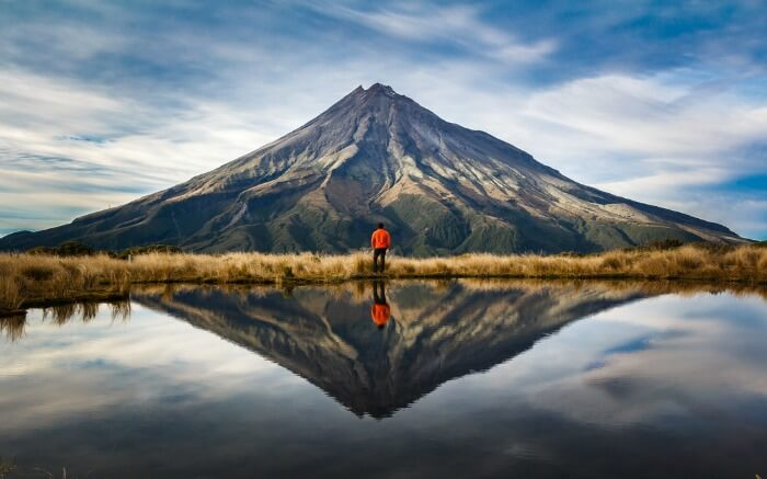 A person exploring the natural beauty of New Zealand