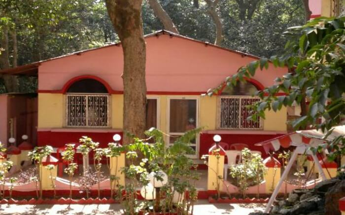 A pink painted hut inside a resort