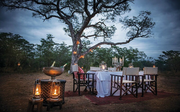 A romantic open air dining setup at Dulini Lodge in Kruger National Park