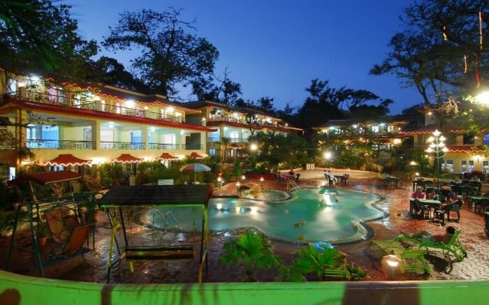 A well lit resort with swimming pool
