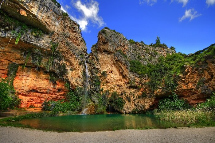 visit the waterfall and cave of Cueva Turche