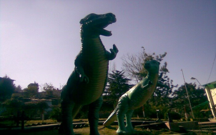 Dinosaur statues in an amusement park