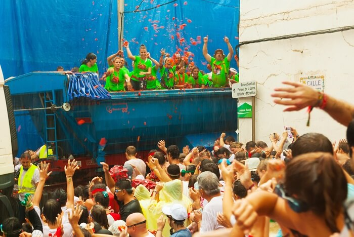 tomatina trucks making their way through bunol