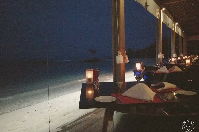 candlelight dinner on beach ambuj honeymoon