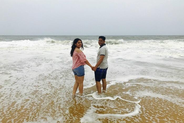 revan aarti kerala beach holding hands