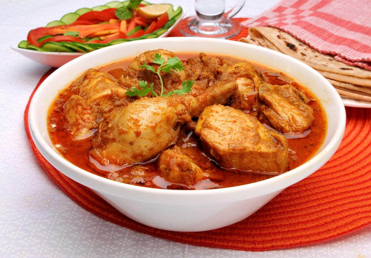 chicken curry in a big white bowl