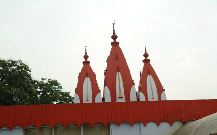 Mankameshwar Temple painted in orange and white colours