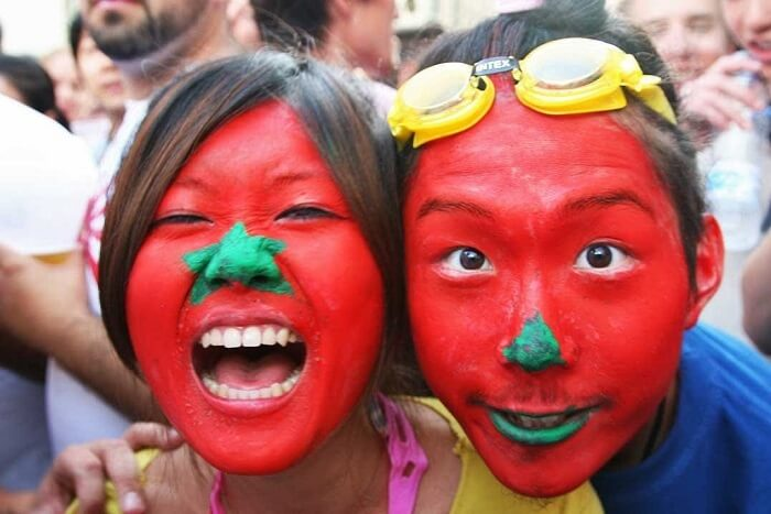 people dressed as tomatoes in tomatina