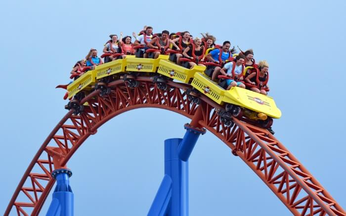 People enjoying on a roller coaster ride