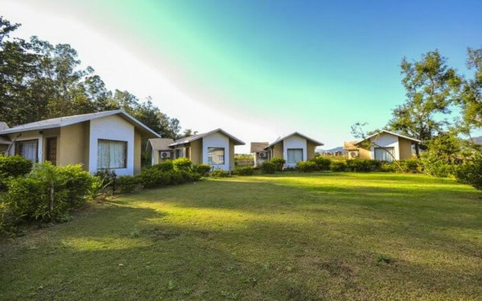 Small cottages with huge green field in a resort